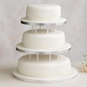 Soft Iced 3 Tier White Wedding Cake with Dowling Madeira (Base tier) & Chocolate Sponge (middle tier) fruit (top tier)